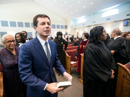 Democratic presidential candidate, South Bend, Indiana Mayor Pete Buttigieg exits a church pew during Sunday service at the Kenneth Moore Transformation Center October 27, 2019 in Rock Hill, South Carolina. Many presidential hopefuls campaigned in the early primary state over the weekend, scheduling stops around a criminal justice forum in …