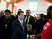 Reverend William Barber walks with South Bend, Indiana mayor and Democratic presidential candidate, Pete Buttigieg, as they leave after Sunday morning service at Greenleaf Christian Church in Goldsboro, North Carolina on December 1, 2019. (Photo by Logan Cyrus / AFP) (Photo by LOGAN CYRUS/AFP via Getty Images)