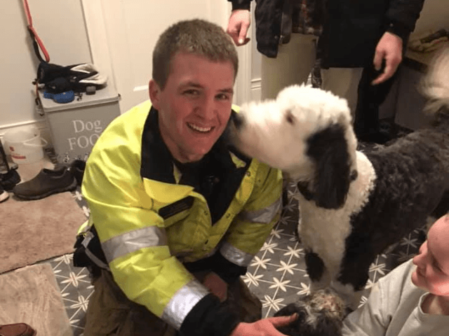 """On Christmas Eve, a dog Charlie ran away, broke through the ice & got stuck in a marsh. Family tried to rescue him, but broke through the ice. Because they were safe on arrival, firefighters in """"mustang suits"""" (ice rescue gear) helped find & reunite Charlie with his family."""