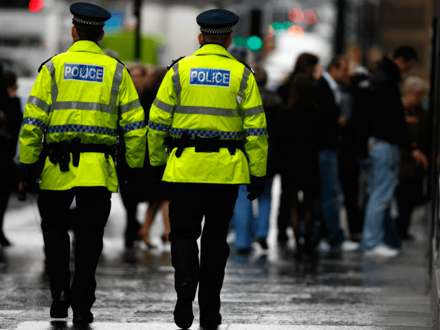 GLASGOW, UNITED KINGDOM - DECEMBER 07: Police officers patrol Buchanan Street in Glasgow, December 7, 2007 in Scotland.There is growing anger as Scotland's police officers will receive a larger pay rise than their colleagues in England and Wales. (Photo by Jeff J Mitchell/Getty Images)