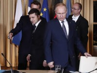 Russian President Vladimir Putin, right, and Ukrainian President Volodymyr Zelenskiy arrive for a working session at the Elysee Palace Monday, Dec. 9, 2019 in Paris. Russian President Vladimir Putin and Ukraine's president are meeting for the first time at a summit in Paris to find a way to end the …