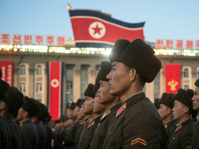 "TOPSHOT - North Korean soldiers attend a mass rally to celebrate the North's declaration on November 29 it had achieved full nuclear statehood, on Kim Il-Sung Square in Pyongyang on December 1, 2017. North Korea's leader Kim Jong-Un declared the country had achieved a ""historic cause"" of becoming a nuclear …"