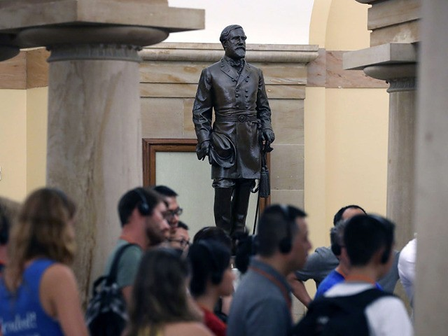 WASHINGTON, DC - AUGUST 17: Tourists walk past the Statue of Confederate General Robert E. Lee that is located inside the US Capitol August 17, 2017 in Washington, DC. House Minority Leader Nancy Pelosi (D-CA) has called for the removal of all Confederate statues from the United States Capitol. (Photo …