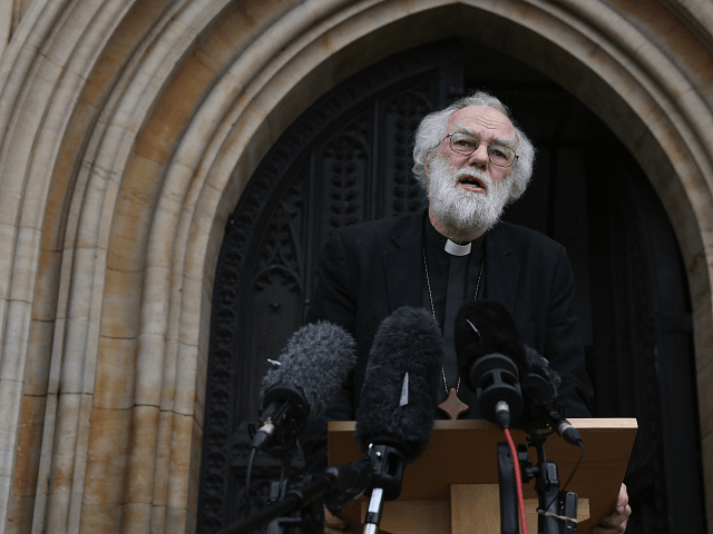 CROYDON, ENGLAND - OCTOBER 17: Former Archbishop of Canterbury Dr Rowan Williams speaks to the media outside Croydon Minster on October 17, 2016 in Croydon, England. Fourteen migrant children from the 'Jungle Camp' in Calais are due to arrive in the UK today to be reunited with relatives. (Photo by …