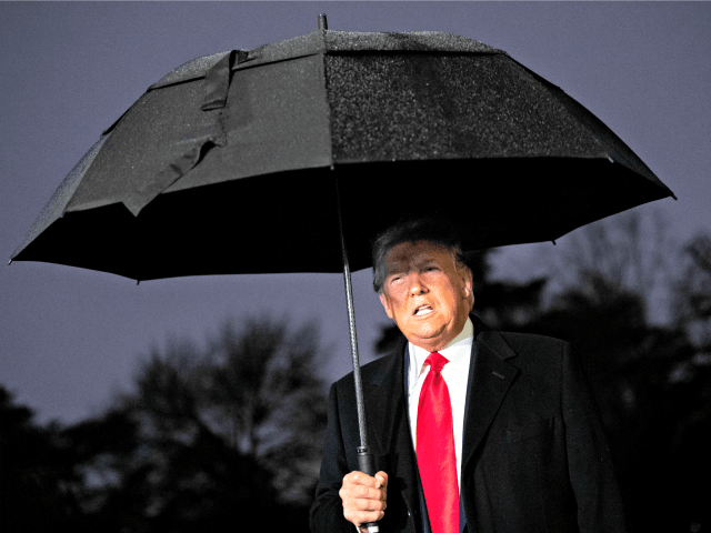 WASHINGTON, DC DECEMBER 10: U.S. President Donald Trump holds an umbrella as he speaks to journalists before boarding Marine One on the South Lawn of the White House on December 10, 2019 in Washington, DC. Trump is headed to Hershey, Pennsylvania for a campaign rally. Earlier in the day, House …