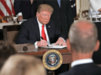 WASHINGTON, DC - JUNE 18: U.S. President Donald Trump signs an executive order during a meeting of the National Space Council at the East Room of the White House June 18, 2018 in Washington, DC. President Trump signed an executive order to establish the Space Force, an independent and co-equal …