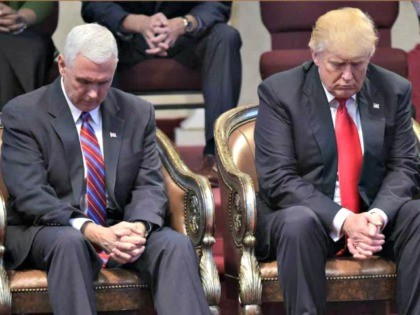 Republican presidential nominee Donald Trump (R) and running mate Mike Pence bow their heads in prayer during the Midwest Vision and Values Pastors and Leadership Conference at the New Spirit Revival Center in Cleveland Heights, Ohio on September 21, 2016.