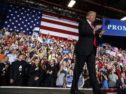 In this July 5, 2018, photo, President Donald Trump turns to the cheering crowd as he arrives for a rally at the Four Seasons Arena at Montana ExpoPark, in Great Falls, Mont. A Roman Catholic bishop in Montana has criticized four priests who attended President Donald Trump's rally in Great …