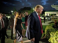 President Donald Trump and first lady Melania Trump arrive for Christmas Eve service at Family Church Downtown in West Palm Beach, Fla., Tuesday, Dec. 24, 2019. (AP Photo/Andrew Harnik)