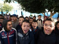 Tunisian schoolchildren sing their national anthem in a primary school in the Tunis suburb of Ariana on March 9, 2016 after having observed a minute of silence for the victims of attacks blamed on the Islamic State group that left dozens dead. Tunisian forces repelled a jihadist assault on a …