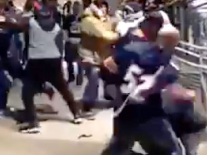 WATCH: Cowboys and Bears Fans Slug it Out in Wild Brawl