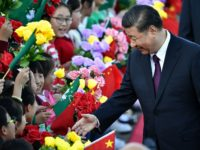 China's President Xi Jinping greets children waving the flags of China and Macau upon his arrival at Macau's international airport in Macau on December 18, 2019, ahead of celebrations for the 20th anniversary of the handover from Portugal to China. - Chinese president Xi Jinping landed in Macau on December …