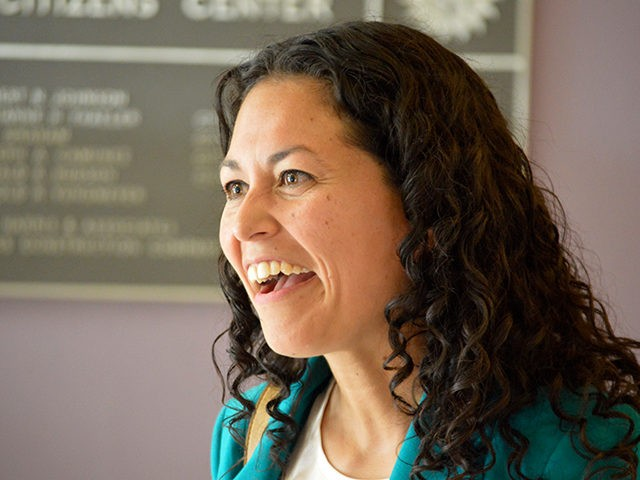 In this May 24, 2018 photo Xochitl Torres Small, a Democratic candidate for Congress, speaks to voters at a Las Cruces, N.M., event. With no mention of President Donald Trump, candidates for an open congressional seat along the U.S. border in New Mexico are blaming Washington politics for the separation …