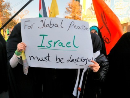 Iranian protesters hold anti-Israeli slogans during a demonstration in the capital Tehran on December 11, 2017 to denounce US President Donald Trump's declaration of Jerusalem as Israel's capital. / AFP PHOTO / ATTA KENARE (Photo credit should read ATTA KENARE/AFP via Getty Images)