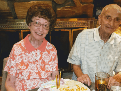 This June 2019 photo provided by Leah Smith shows Les and Freda Austin of Jackson, of Michigan, pose for a photo at a birthday party. The Michigan couple, who family members say did everything together for 70 years up to their final breaths, died 20 minutes apart in the same …