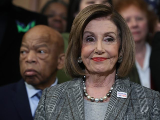 WASHINGTON, DC - DECEMBER 06: House Speaker Nancy Pelosi (D-CA) stands with Rep. John Lewis (D-GA) (L) and other members during a news conference before the House votes on the H.R. 4, The Voting Rights Advancement Act, on December 6, 2019 in Washington, DC. When the president signs the act …