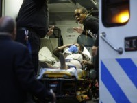 A protester is seen inside of an ambulance after being arrested during a rally on April 29, 2015 at Union Square in New York, held in solidarity with demonstrators in Baltimore, Maryland demanding justice for an African-American man who died of severe spinal injuries sustained in police custody. AFP PHOTO/Eduardo …