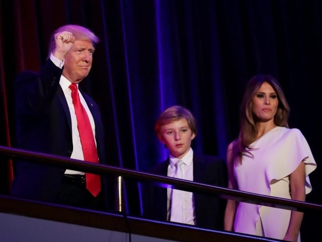 NEW YORK, NY - NOVEMBER 09: Republican president-elect Donald Trump acknowledges the crowd along with his son Barron Trump and his wife Melania Trump during his election night event at the New York Hilton Midtown in the early morning hours of November 9, 2016 in New York City. Donald Trump …