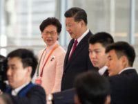 Hong Kong's Chief Executive Carrie Lam and China's President Xi Jinping arrive at the opening ceremony of the Hong Kong-Zhuhai-Macau Bridge at the Zhuhai Port terminal on October 23, 2018. - China's President Xi Jinping launched the world's longest sea bridge connecting Hong Kong, Macau and mainland China on October …