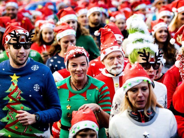 People take part in an Ugly Christmas Sweater Run on December 16, 2017 in The Vondelpark in Amsterdam. / AFP PHOTO / ANP / Koen van Weel / Netherlands OUT (Photo credit should read KOEN VAN WEEL/AFP via Getty Images)