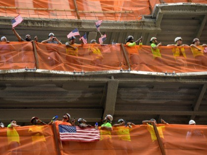 NEW YORK, NEW YORK - JULY 10: Construction workers cheer on he U.S. Women's National Soccer Team during their Victory Parade and City Hall Ceremony down the Canyon of Heroes on July 10, 2019 in New York City. (Photo by Michael Loccisano/Getty Images)