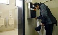 dispenser in restroom in China