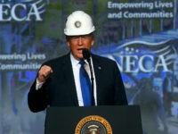 PHILADELPHIA, PA - OCTOBER 2: U.S. President Donald Trump wears a hard hat as he addresses the National Electrical Contractors Convention on October 2, 2018 in Philadelphia, Pennsylvania. The National Electrical Contractors Convention is the largest gathering of manufacturers and distributors for electrical professionals in North America. (Photo by Mark …