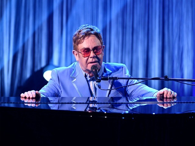"""BURBANK, CALIFORNIA - OCTOBER 16: Elton John performs live on stage at iHeartRadio ICONS with Elton John: Celebrating The Launch Of Elton John's Autobiography, """"Me"""" at the iHeartRadio Theater Los Angeles on October 16, 2019. (Photo by Kevin Winter/Getty Images for iHeartMedia)"""