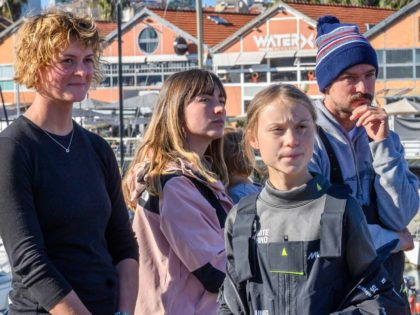 LISBON, PORTUGAL - DECEMBER 03: (L-R) British professional yachtswoman Nicola Henderson, yacht owners Elayna Carausu and her husband Riley Whitelum, with their son, and Swedish teen climate activist Greta Thunberg in Santo Amaro Recreation dock on December 03, 2019 in Lisbon, Portugal. Greta Thunberg sailed from Norfolk, Virginia, USA , …