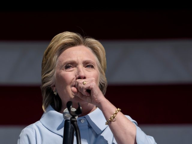 Democratic presidential nominee Hillary Clinton coughs during a Labor Day rally September 5, 2016 in Cleveland, Ohio. Hillary Clinton launched the home stretch of her US presidential bid aiming to solidify her advantages over rival Donald Trump, with both candidates converging on working-class Ohio as ground zero of their 2016 …