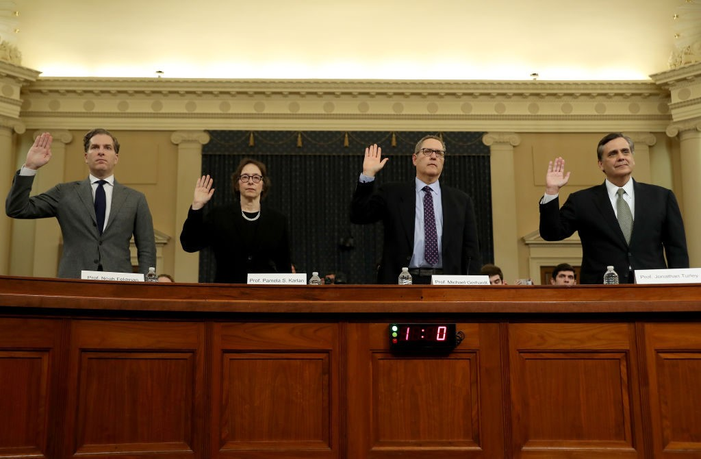 WASHINGTON, DC – DECEMBER 4: Constitutional scholars Noah Feldman of Harvard University, Pamela Karlan of Stanford University, Michael Gerhardt of the University of North Carolina, and Jonathan Turley of George Washington University are sworn in to testify before the House Judiciary Committee in the Longworth House Office Building on Capitol Hill December 4, 2019 in Washington, DC. This is the first hearing held by the Judiciary Committee in the impeachment inquiry against U.S. President Donald Trump, whom House Democrats say held back military aid for Ukraine while demanding it investigate his political rivals. The Judiciary Committee will decide whether to draft official articles of impeachment against President Trump to be voted on by the full House of Representatives. (Photo by Chip Somodevilla/Getty Images)