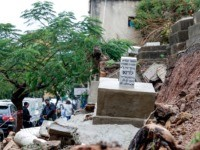 This picture taken on December 26, 2019 shows a grave dating back to 1942 that was damaged as it fell in a mudslide during bad weather in a winter storm at the Jewish cemetery in the Lebanese capital Beirut. - Entire grave stones spiled onto a street in the Lebanese …