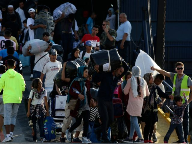Refugees and migrants arrive at the port of Thessaloniki, northern Greece, Monday, Sept. 2, 2019. About 1,500 asylum-seekers were being transported from Greece's eastern Aegean island of Lesbos to the mainland Monday as part of government efforts to tackle massive overcrowding in refugee camps and a recent spike in the …