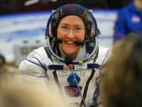 FILE - In this Thursday, March 14, 2019 file photo, U.S. astronaut Christina Koch, member of the main crew of the expedition to the International Space Station (ISS), speaks with her relatives through a safety glass prior the launch of Soyuz MS-12 space ship at the Russian leased Baikonur cosmodrome, …