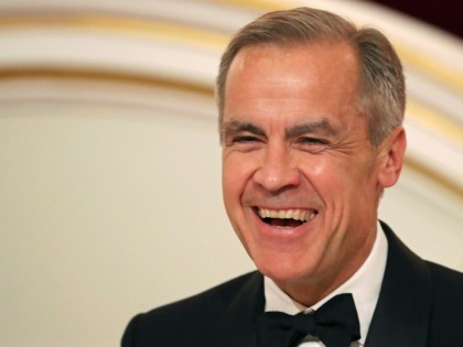 "LONDON, ENGLAND - JUNE 20: Governor of the Bank of England Mark Carney reacts during the annual Mansion House dinner on June 20, 2019, in London, England. Greenpeace volunteers wearing red evening dress with sashes reading ""climate emergency"" gatecrashed and disrupted the beginning of Chancellor Philip Hammond's Mansion House speech. …"