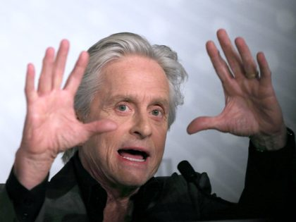 "US actor Michael Douglas gestures on May 21, 2013 while talking during a press conference for the film ""Behind the Candelabra"" presented in Competition at the 66th edition of the Cannes Film Festival in Cannes. Cannes, one of the world's top film festivals, opened on May 15 and will climax …"