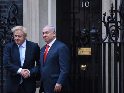 Britain's Prime Minister Boris Johnson (L) greets Israel's Prime Minister Benjamin Netanyahu outside 10 Downing Street in central London on September 5, 2019. (Photo by Oli SCARFF / AFP) (Photo credit should read OLI SCARFF/AFP via Getty Images)