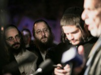 Orthodox Jewish people listen to N.Y. state Assemblyman Dov Hikind speak in Monsey, N.Y., Sunday, Dec. 29, 2019, following a stabbing late Saturday during a Hanukkah celebration. A man attacked the celebration at a rabbi's home north of New York City late Saturday, stabbing and wounding several people before fleeing …