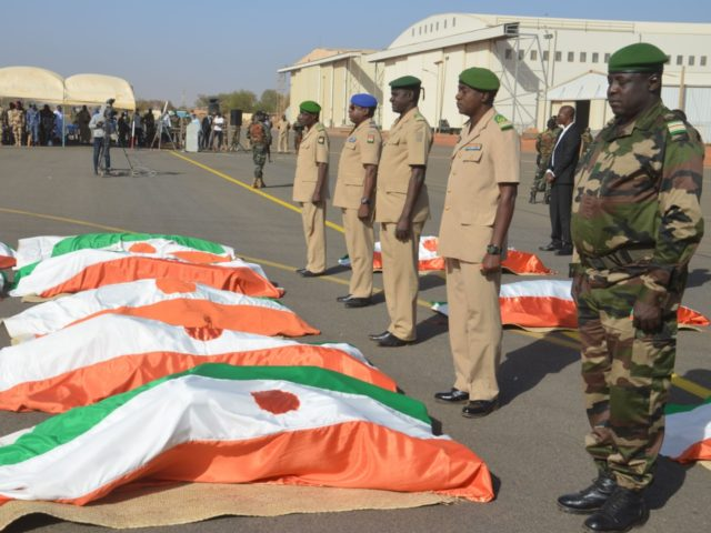 Personnel of the Niger Military pay tribute to the military personnel, that was killed in an attack, at the funeral prayer at the Niamey Airforce Base in Niamey, on December 13, 2019. - 71 Military personnel died in an attack on a military camp in Inates in the western Tillaberi …