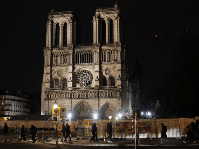 Notre Dame cathedral is pictured in Paris, Tuesday, Dec. 24, 2019. Notre Dame Cathedral is unable to host Christmas services for the first time since the French Revolution, because the Paris landmark was too deeply damaged by this year's fire. (AP Photo/Thibault Camus)