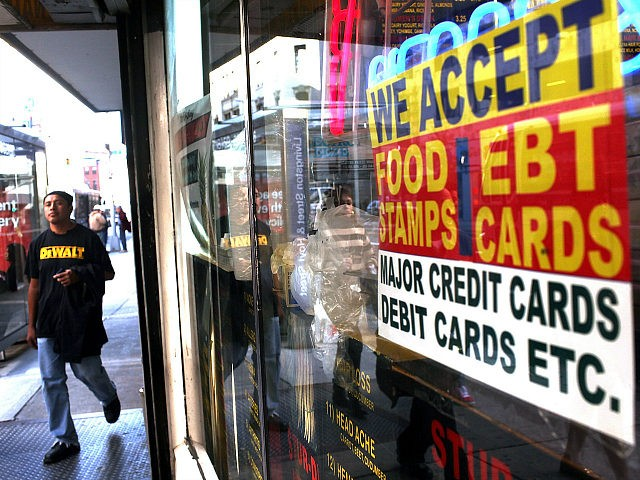 NEW YORK - OCTOBER 07: A sign in a market window advertises the acceptance of food stamps on October 7, 2010 in New York City. New York Mayor Michael Bloomberg is proposing an initiative that would prohibit New York City's 1.7 million food stamp recipients from using the stamps, a …