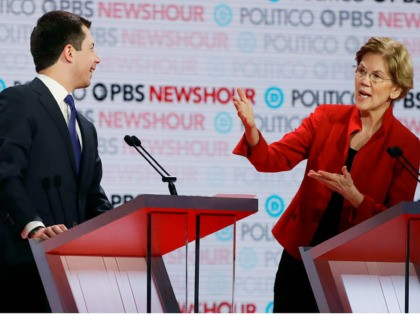 Democratic presidential candidate Sen. Elizabeth Warren, D-Mass., speaks as South Bend Mayor Pete Buttigieg listens during a Democratic presidential primary debate Thursday, Dec. 19, 2019, in Los Angeles. (AP Photo/Chris Carlson)