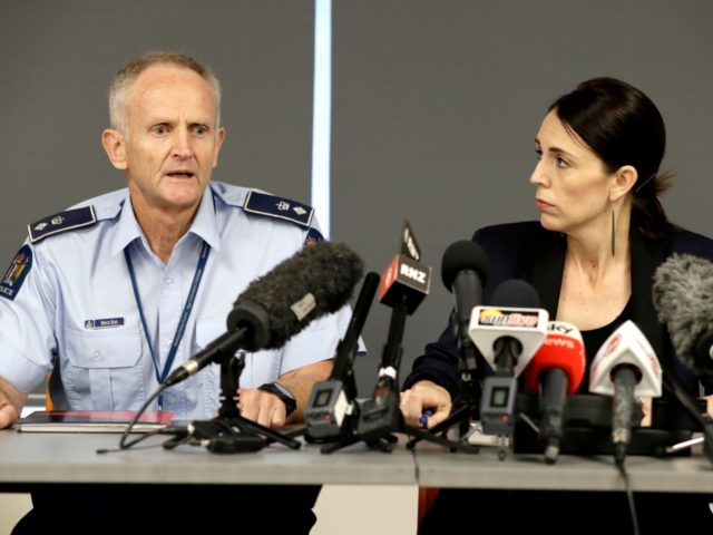 New Zealand Prime Minister Jacinda Ardern watches as police Superintendent Bruce Bird, left, addresses a press conference in Whakatane, New Zealand, Tuesday, Dec. 10, 2019. A volcanic island in New Zealand erupted Monday Dec. 9 in a tower of ash and steam while dozens of tourists were exploring the moon-like …