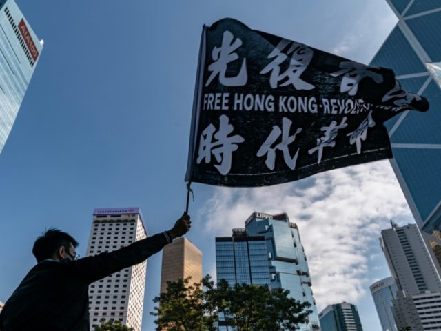 HONG KONG, CHINA - DECEMBER 2: Professionals from advertising sector take part in a rally to commence a five day strike on December 2, 2019 in Hong Kong, China. Anti-government protests in Hong Kong stretched into its sixth month after scoring a major victory in the District Council elections as …
