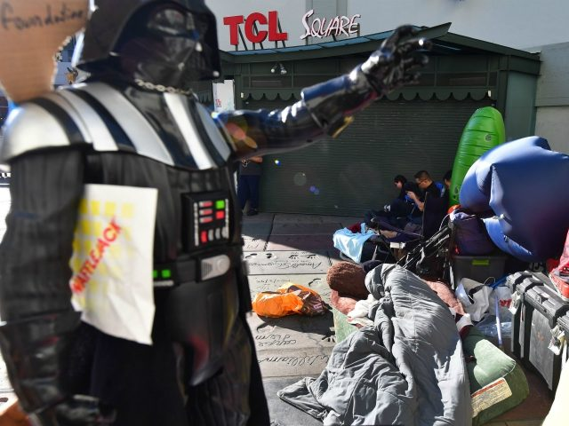 "Star Wars fans sleep and wait on line outside the TCL Chinese Theater in Hollywood, California on December 13, 2019, where many have been waiting since December 10 over a week in advance of the December 19 opening of the latest Star Wars film ""The Rise of Skywalker."" (Photo by …"