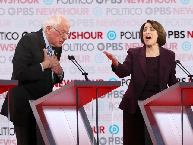 Democratic presidential candidate Sen. Bernie Sanders (I-VT) reacts to Sen. Amy Klobuchar (D-MN) during the Democratic presidential primary debate at Loyola Marymount University on December 19, 2019 in Los Angeles, California. Seven candidates out of the crowded field qualified for the 6th and last Democratic presidential primary debate of 2019 …