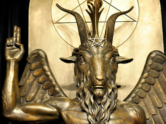 """The Baphomet statue is seen in the conversion room at the Satanic Temple where a """"Hell House"""" is being held in Salem, Massachusett on October 8, 2019. - The Hell House was a parody on a Christian Conversion centre meant to scare atheist and other Satanic Church members. (Photo by …"""