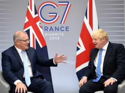 BIARRITZ, FRANCE - AUGUST 24: British Prime Minister Boris Johnson (R) meets Australian Prime Minister Scott Morrison (L) for their bilateral talks during the G7 Summit on August 24, 2019 in Biarritz, France. The French southwestern seaside resort of Biarritz is hosting the 45th G7 summit from August 24 to …