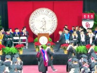 Nathaniel Beale's ten-year-old son, Noah, took his place at his University of Oklahoma graduation on Saturday.