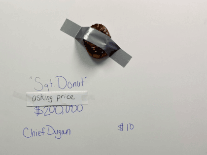 """Tampa's finest piece of art work is on display at TPD. The cities most elite artist, @ChiefDugan created this one of a kind piece,""""Sgt. Donut"""". Asking price $200,000 Who will be our highest bidder? Bidding starts at $10! """"Ten dollars ,twenty dollars do we hear $30?"""